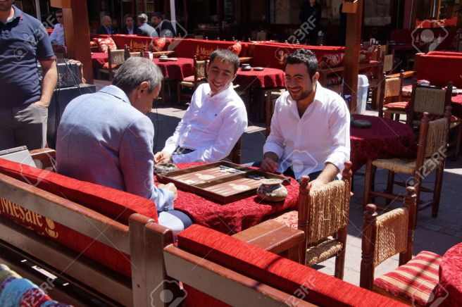 Two men enjoying a game of backgammon